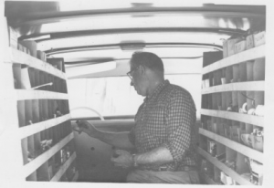 The Grandfather working in the back of the truck.