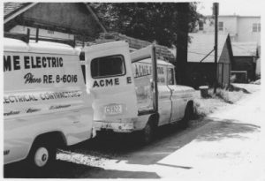 Acme work electrical trucks with the door open.