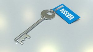 A key with a tag on it saying success.