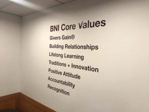 BNI core values written on a wall.