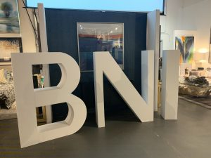A large BNI sign in the room