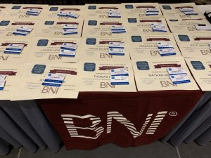 A BNI badge table.