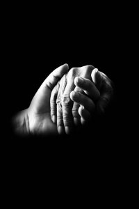 Holding hands in a compassionate way.