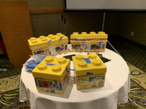 Yellow lego building boxes on the table.