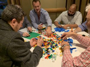A table filled with lego at a BNI meeting.