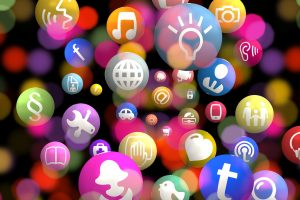 Multicolred thoughts of music and facebook and family showing skills.