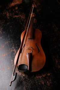 A violin placed on the floor.