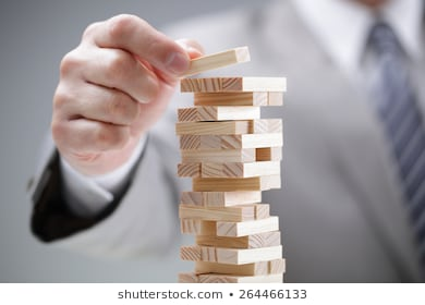A man stacking up building blocks.