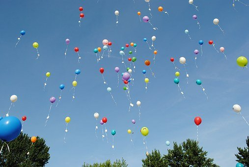 Balloons being released into the air in celebration of winning.