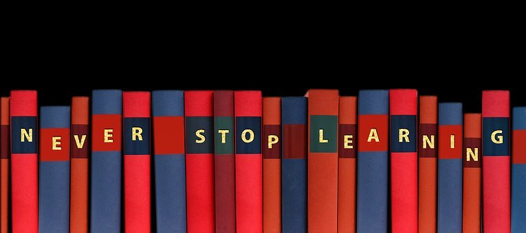 Never Stop Learning written on books in a row.