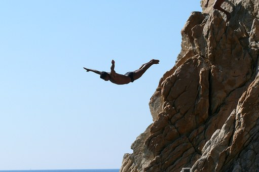 A man diving off a cliff.